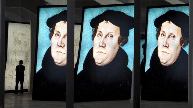 Ausstellung mit drei Lutherbildern