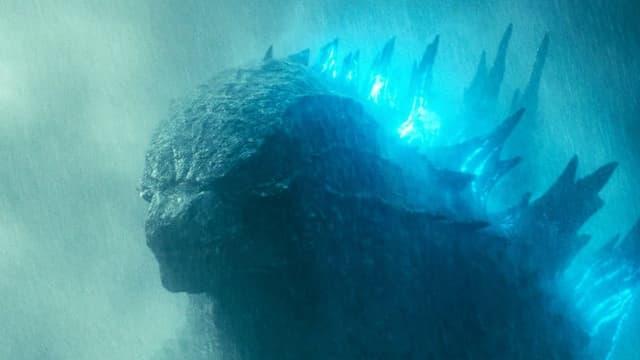 Der Kopf von Godzilla, seine Rückenschuppen leuchten bläulich.