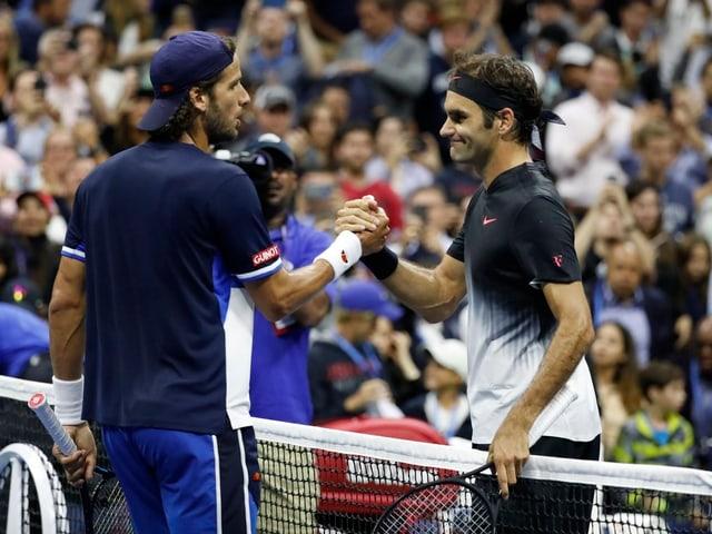 Feliciano Lopez und Roger Federer.