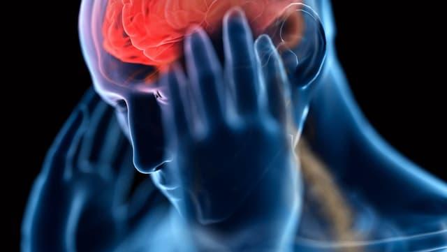Eine Darstellung eines Menschen mit gerötetem Hirn