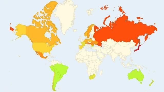 Eine Weltkarte. Manche Länder sind rot, andere orange, andere grün eingefärbt.