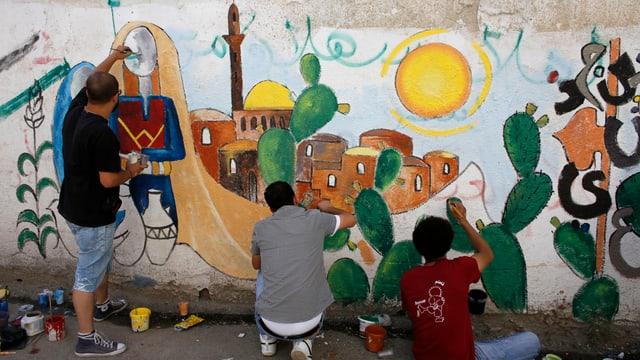 Palästinenser malen ein Graffiti mit Felsendom und Al-Aqsa Moschee in Jerusalem