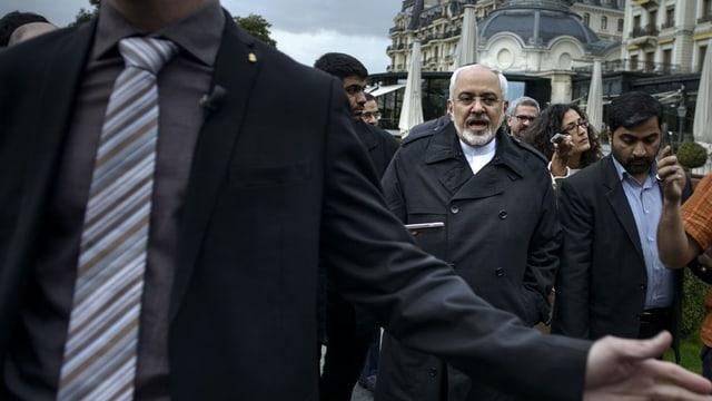 Il minister da l'exteriur iranais Mohammed Dschawad Sarif protegì da ses bodyguards.