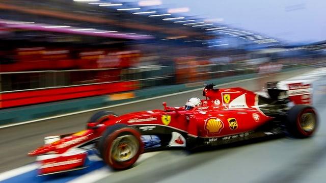 Sebastian Vettel en ses auto da cursa.