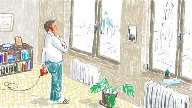 Ein Mann telefoniert in einer Wohnung.
