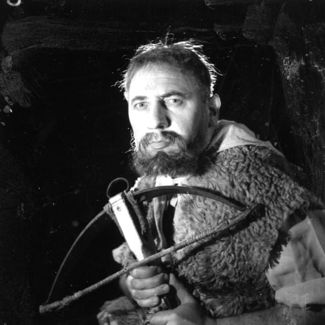 Schwarz-Weiss Bild eines als Wilhelm Tell verkleideten Schauspieler