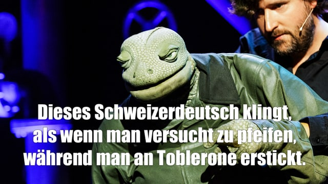 """Foto der Echse mit ihrem Spruch: Dieses Schweizerdeutsch klingt, als wenn man versucht zu pfeifen, während man an Toblerone erstickt."""""""
