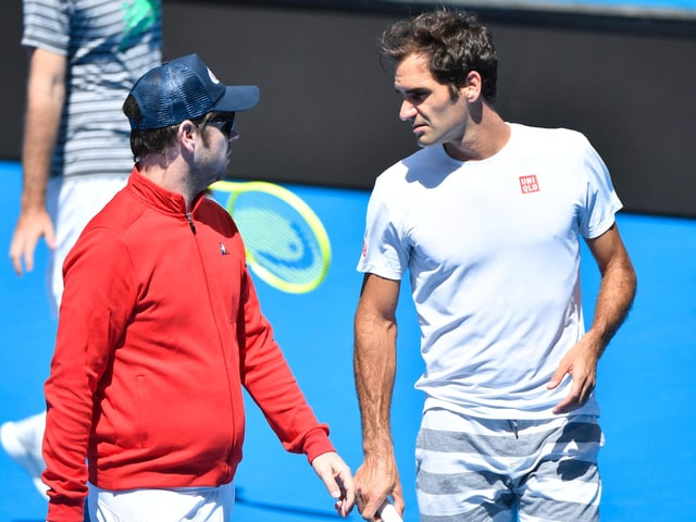 Severin Lüthi (links) und Roger Federer im Training