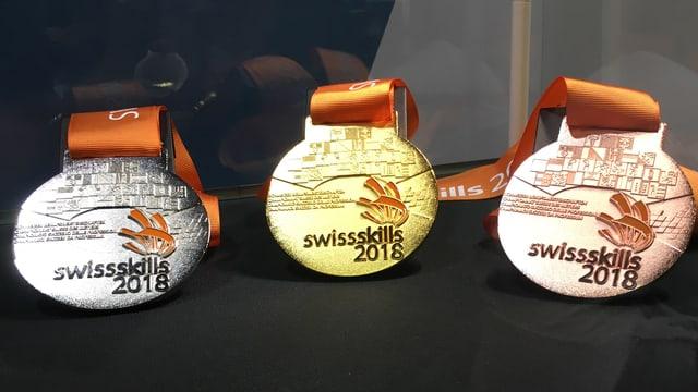 medaglias (argient, aur e bronz) dals Swiss Skills 2018