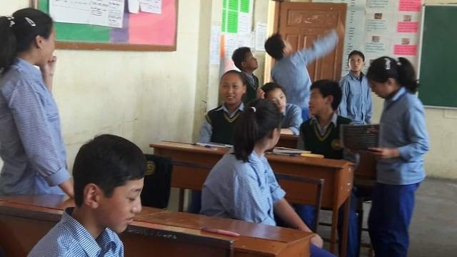 En scola.