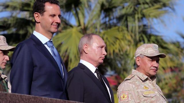 Syriens Staatschef Assad mit Russlands Präsident Putin bei dessen Besuch in Syrien im Dezember 2017.