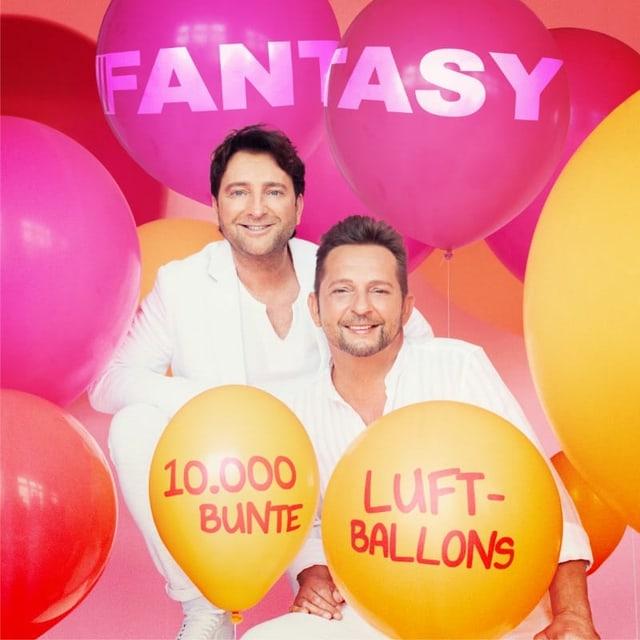 Zwei Männer und bunte Luftballone auf einem Plattencover.