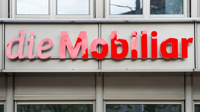 il logo da la Mobigliar vi da la sedia principala a Berna
