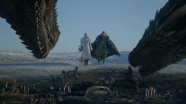 Zwei Drachen und zwei Menschen.