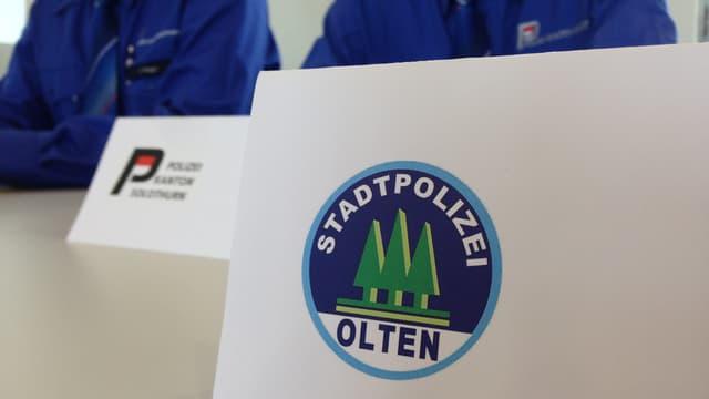 Logos beider Polizeien.