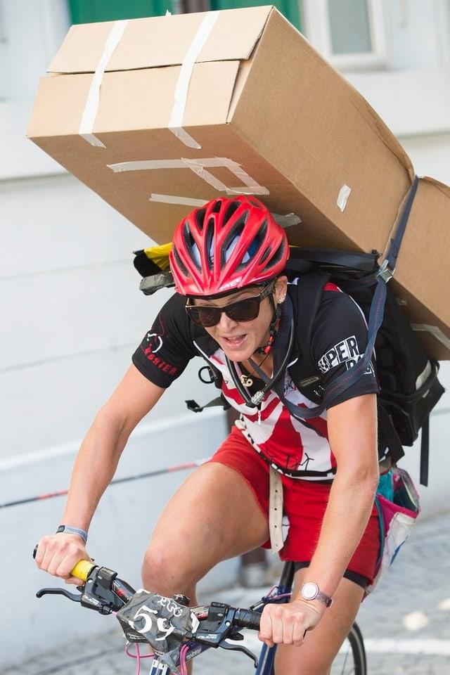 ciclista durant ina disziplina als campiunadis 2013 a Losanna