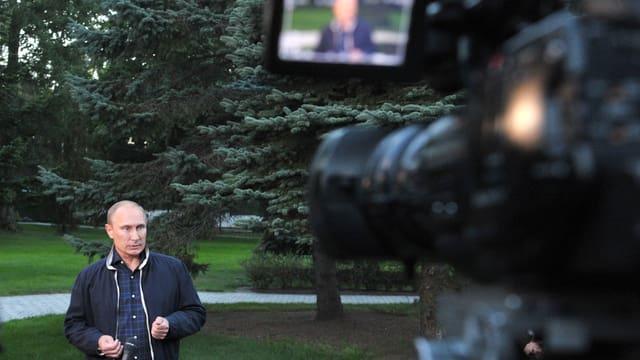 Putin an einer Medienkonferenz