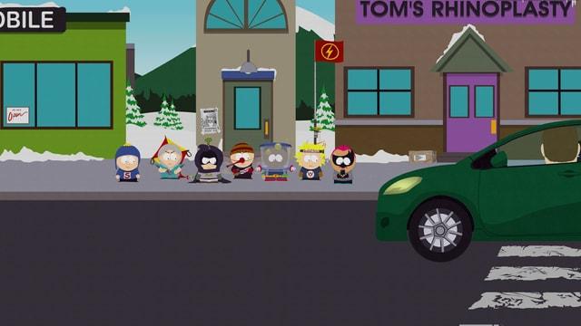 Grünes Auto im Vordergrund, im Hintergrund Kids mit runden Köpfen.