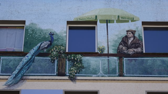 Thomas Müntzer wurde auf eine Hauswand gemalt.