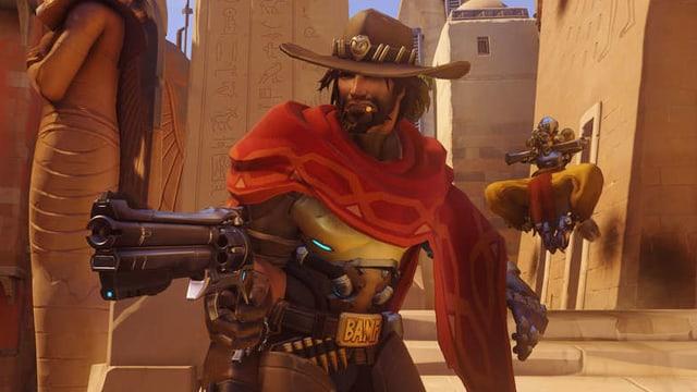 Auf dem Bild zu sehen ist Jesse McCree ein sogenannter Damage Hero. Er sieht aus wie ein klassischer Cowboy, der 6 Schüsse in seinem Peacekeeper Revolver geladen hat.