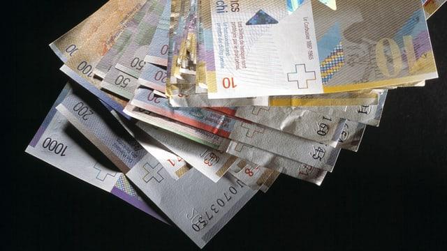 Purtret da bancnotas da 1'000 enfin 10 francs.