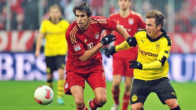 Der Transfer von Mario Götze (r.) verleiht dem sportliche bedeutungslosen Duell Brisanz.