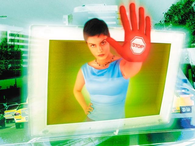 Symbolbild: Frau streckt ihre Hand aus Computerbild und signalisiert Stop.