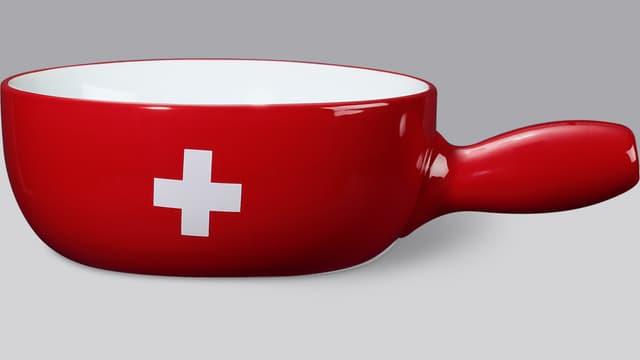 Rotes Fondue-Caquelon mit Schweizer Kreuz.