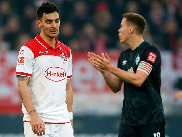 Kaan Ayhan (links) und Niklas Moisander.