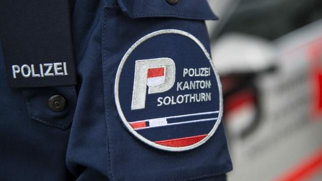 Giacca cun il logo da la Polizia chantunala da Soloturn.