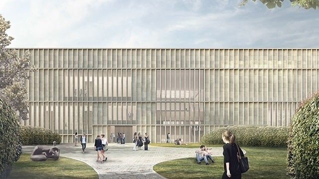 Eine Visualisierung des Erweiterungsbaus: ein vierstöckiges Gebäude, davor Wiese.