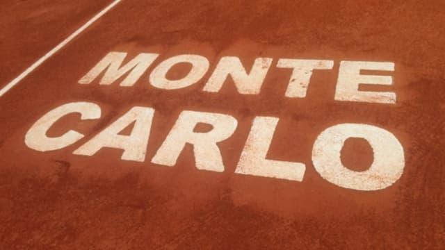 Schriftzug «Monte Carlo» auf einem Sandplatz