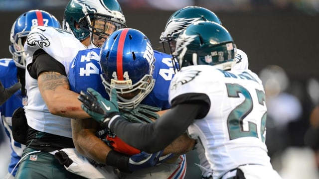 Ausgebremst: Titelverteidiger New York Giants (hier Ahmad Bradshaw mit Nummer 44) verpassen die Playoffs.