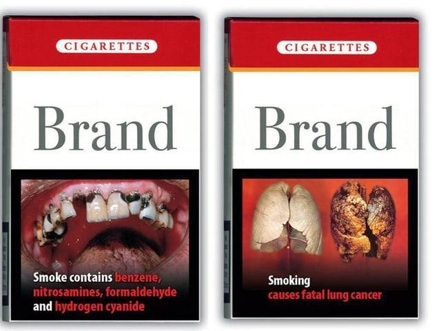 Bilder von schwarzen Lungen und Zähnen, die auf Zigarettenschachteln abgebildet sind.