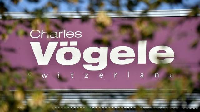 Purtret dal logo da Charles Vögele.
