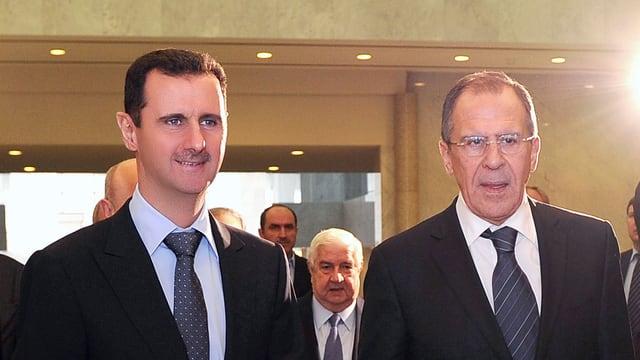 Assad (l.) und Lawrow.