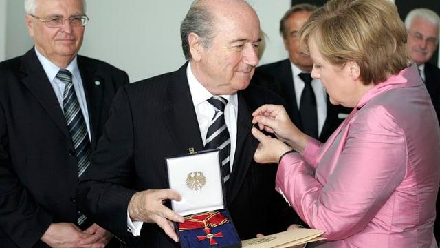 Joseph Blatter und Angela Merkel