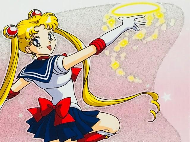 Auf dem Bild sieht man die Animefigur Sailor Moon, wie sie ihren Mondstein wirft