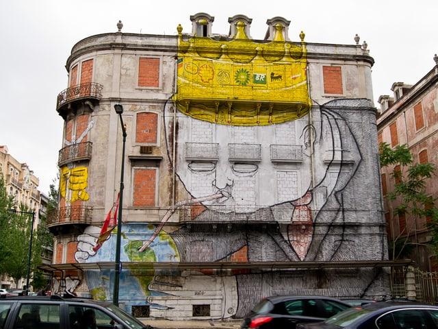Graffito auf einem Haus in Lissabon: Ein Geschäftsmann, bekrönt mit den Emblemen internationaler Ölkonzerne, saugt die Erde mit einem Strohhalm aus.
