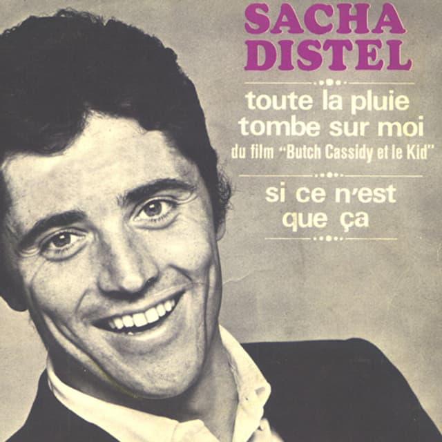 Sacha Distel auf dem schwarzweissen Cover seiner Single.