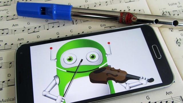 Handy liegt auf Notenblättern. Darauf sieht man einen Roboter, der Geige spielt.