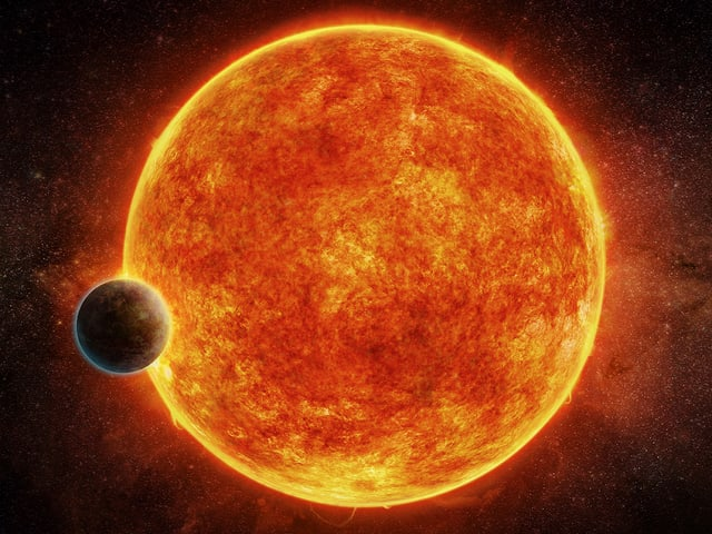 Illustration des Exoplaneten LH 1140b mit seiner Sonne im Hintergrund