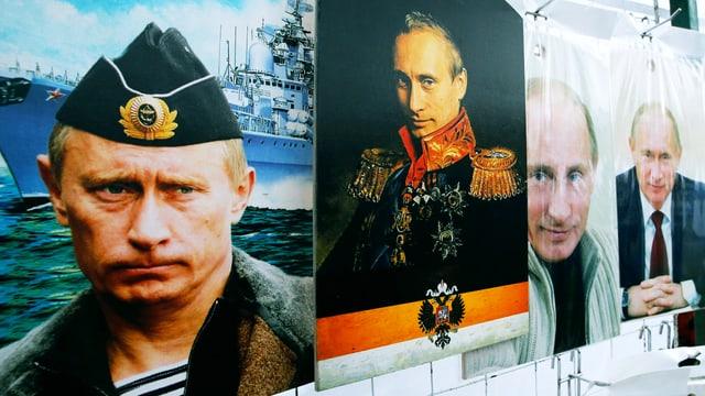 Plakate von Putin hängen in einem Verkaufsstand.