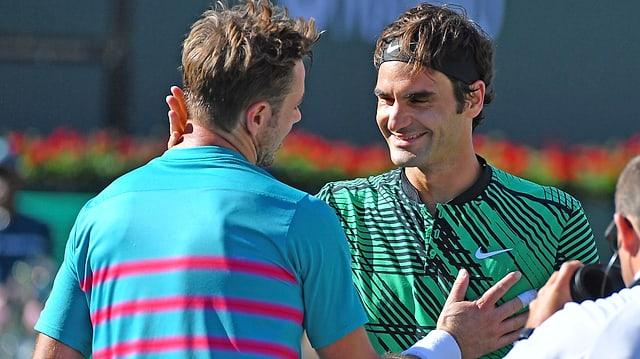 Roger Federer (rechts) und Stan Wawrinka nach einem Spiel