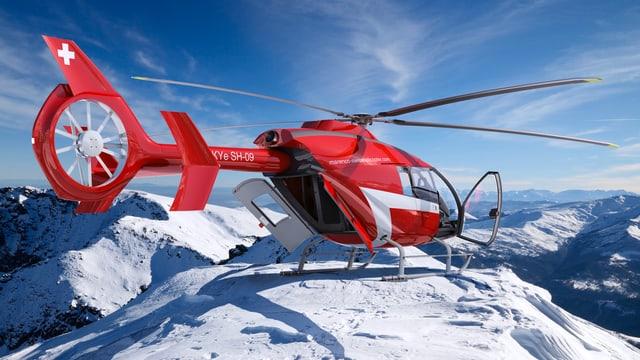 Ein roter Marenco-Helikopter auf einem schneebedeckten Berg.