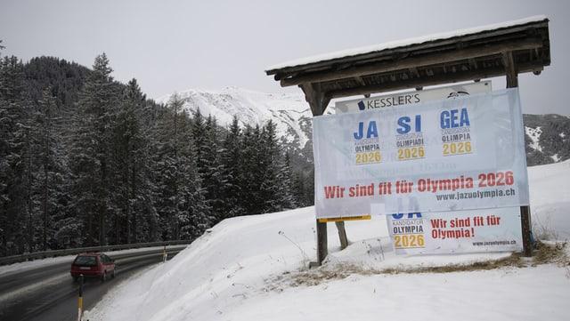 Placat dals promoturs per gieus olimpics en il Grischun.