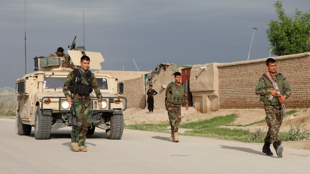 Purtret d'in trup militar ad Afghanistan.
