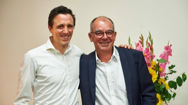 Pascal Jenny (sanestra) ensemen cun il president actual Christian Menet.