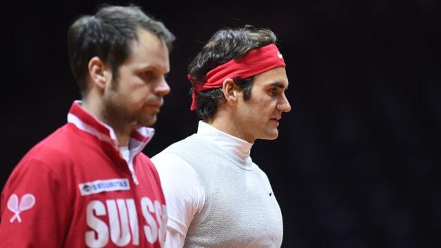 Lüthi und Federer mit ernster Miene.
