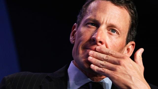 Lance Armstrong mit nachdenklicher Mimik.